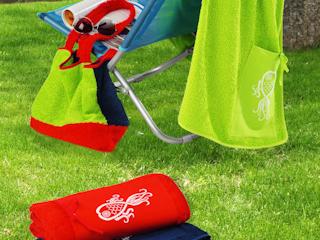 Z modnym ręcznikiem Greno na plażę